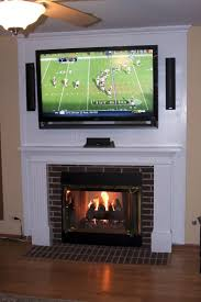 furniture white mounting tv over fireplace hiding wires with