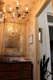 new orleans french powder room with kitchen and bath designers eclectic wall paper shabby chic
