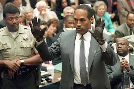 be chris darden was just doing his job o j simpson shows the jury a new pair of aris extra large gloves similar
