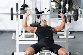 Young Bodybuilder Training In The Gym: Chest - Barbell Incline ...