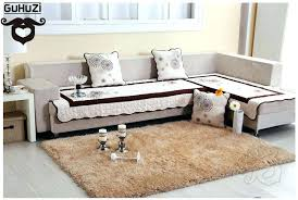 area rug on top of carpet over ideas in living pad definition liv