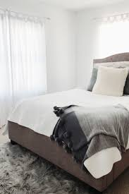 White and grey bedroom gray headboard white walls paint