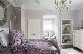 white canopy bed with purple bedding