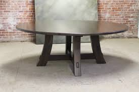 reclaimed wood round farm table with modern pedestal