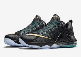 lebron james shoes 12 black. nike lebron 12 low. color: black/metallic gold-anthracite-radiant emerald style code: 724557-070. release date: september 3rd, 2015. price: $175 lebron james shoes black 2