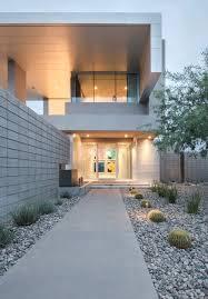 front garden glass front door mid century modern home in scottsdale arizona