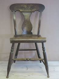 a 19th century painted kitchen chair