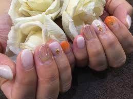 Nail Salon Freestyleスタッズユニコーンで夏ネイル白オレンジグラデ