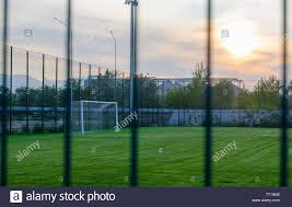 Football Field With Green Lawn At Sunset Sports And Team
