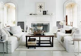 fascinating white living room design with white sofa and beautiful glass table on the rug ideas furnished with electric fireplace and enchanting clock beautiful white living room