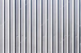 corrugated grey fence steel siding background texture photo by mrtwister