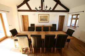 the 2 4 2 9m tallinn erfly extending european oak table shown with 10 stunning an luxury dark brown leather chairs d at 1679