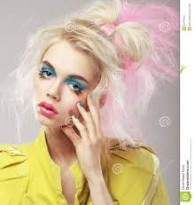 portrait of bright blonde with gy hair and blue eye makeup glam
