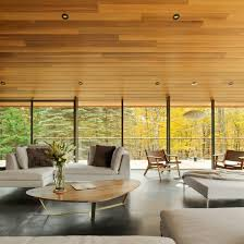 abundant glazing and wrap around terraces feature in vermont home by j roc design