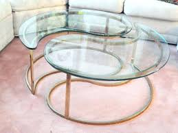yin yang coffee table pair of regency brass plated end by glass br