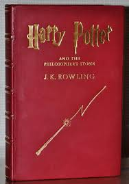 harry potter and the philosopher s stone 1st 1st bloomsbury printing rebound in red leather and gilt accents