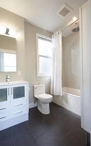 subway tile in bathroom Bathroom Transitional with dark gray floor
