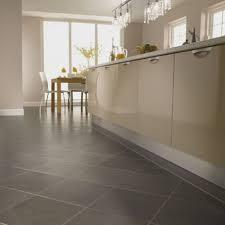 modern kitchen floor tile. Modern Kitchen Cabinets With Linear Chandelier And Cozy Laminate Floor Tiles For Design Tile C