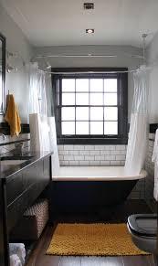 Clawfoot tub + shower, subway tile, reclaimed wood floors, small bathroom  ($5000