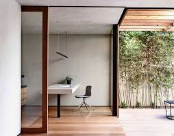 view in gallery minimal corner home office that opens up into the rear yard aussie lighting world