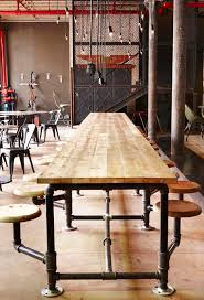 industrial cafe furniture. truth coffee shop in cape town by haldane martin communal table and industrial cafe furniture u