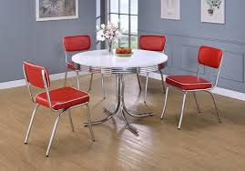 round retro table with red chairs