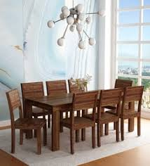 segur solid wood eight seater dining set in provincial teak finish