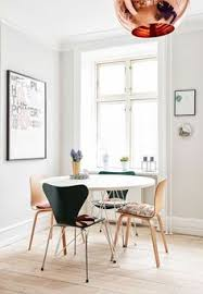 dining corner with danish design two from arne jacobsen around the dining table from designdelicatessen along with two muuto chairs