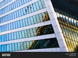 glass exterior modern office. Skyscraper Exterior Design. Abstract View Of Window, Mirror Reflection And Detail Architecture Close- Glass Modern Office R