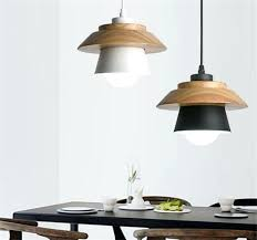 is a minimalist hanging lamp in form of hat or cap wooden pendant light uk