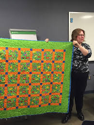 Capital Area Modern Quilt Guild & Beth shared her orange and green charity quilt which she is considering  sending to Las Vegas as the Las Vegas Modern Quilt Guild asked for  donations. Adamdwight.com