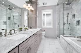 master bathroom with calacatta gold marble countertop vanity and carrara subway tile in shower