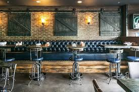 in irvine in america bos kitchen libations has a more down to earth feel the restaurant s design vision was to create a e with a rustic farm