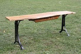 custom made live edge cherry bench or coffee table with antique cast iron adjule legs