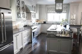 light gray kitchen cabinets with black countertops home safe