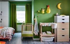 a bedroom with a crib in beech combined with a changing table in beech and a baby nursery decor furniture uk