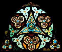 stained glass window details below narthex front doors detail triangles trefoils and fleurs de lis are symbolic of the trinity in ity