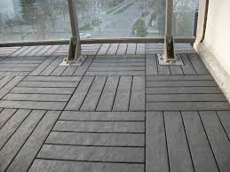 Charcoal-Grey floor decking tiles on balcony floor. We supply and install.  Better