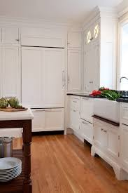 traditional kitchen with integrated refrigerator