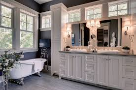 traditional bathroom lighting ideas white free standin. Bathroom Trim Ideas Traditional With White Shaker Panel Cabinets His And Hers Freestanding Tub Lighting Free Standin