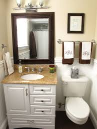 bathroom cabinet remodel. Home Depot Bathroom Remodel With Toilet Under Small Towel Bar And Single Sink Vanity Framed Mirror Also Wall Sconces Cabinet .