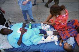 u s  department of defense  photo essay     a haitian family waits outside university hospital after being treated  jan