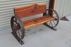 Check Out Our New Cedar Benches with Antique Wagon Wheels