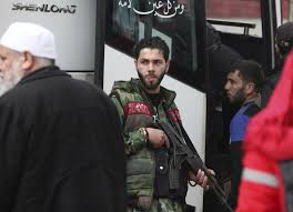 homs syria scores of syrian opposition fighters and their families began leaving the last rebel held neighborhood in the central city of homs on saay