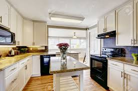 White Kitchen Island With Granite Top White Kitchen Cabinets With Black Appliances Kitchen Island