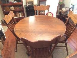 antique round oak dining room table with 2 extension leaves 4 chairs