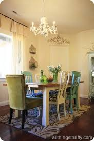 i love mismatched chairs around a dining table i ll be doing this when