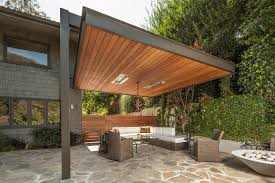 modern patio covers Patio Contemporary with awning climbing plants