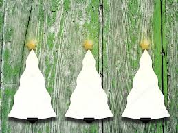 three hanged tree shaped frames with star on weathered wooden boards stock photo