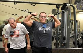 left laugh as they work out at la fitness in oakdale on wednesday feb 13 2019 cosentino who has struggled with his weight since childhood